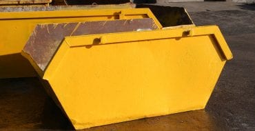 Bright yellow skip used in the removal of construction waste.